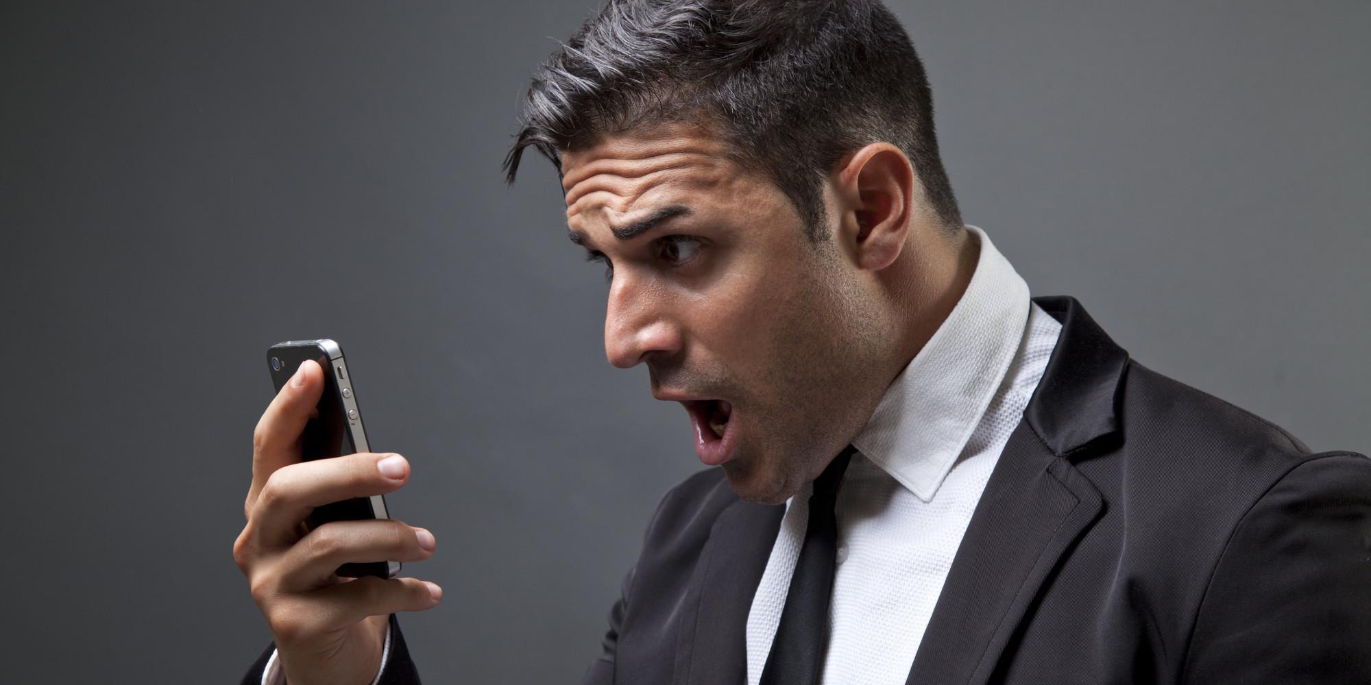 angry-man-looking-at-phone
