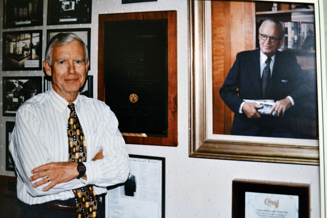 C.W. Conn Jr. with a portrait of his father.